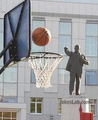 funny statue playing basketball