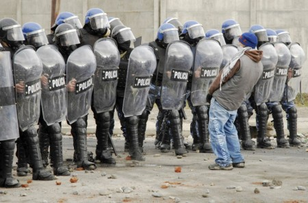 funny-protester-peeing-on-riot-police