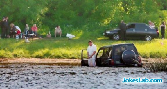 man driving car into water to pee, only seen in Australia