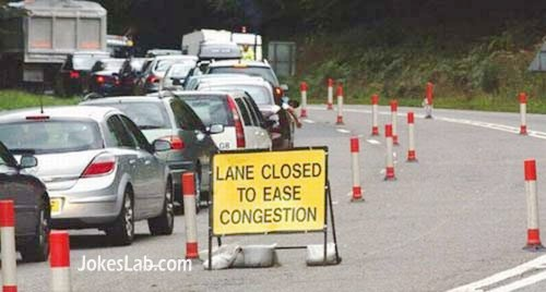 funny road sign, lane closed to ease congestion