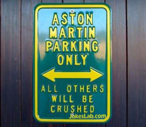 funny no parking sign, crushed except Aston Martin