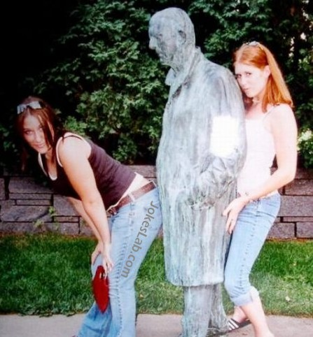 funny pose, group sex by two girls and a statue