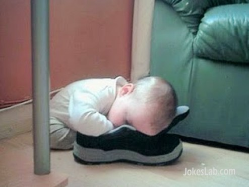 funny baby sleeping with shoes