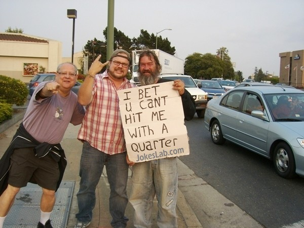 funny sign, I bet you cannot hit me with a quarter