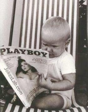 funny boy is reading a playboy magazine