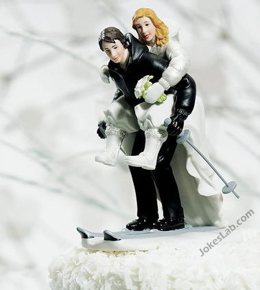 funny wedding cake with skiing couple, ready for sex
