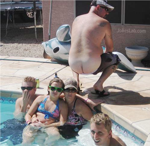 funny family photo in swimming pool, naked buttocks