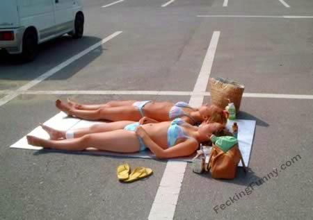 sexy-girls-sun-bath-in-car-park